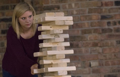 Fallon Kitchens, a freshman undecided major, watches as the life-size Jinga blocks wabble during the third day of ROC Fest in 7th Street Underground on Wednesday.