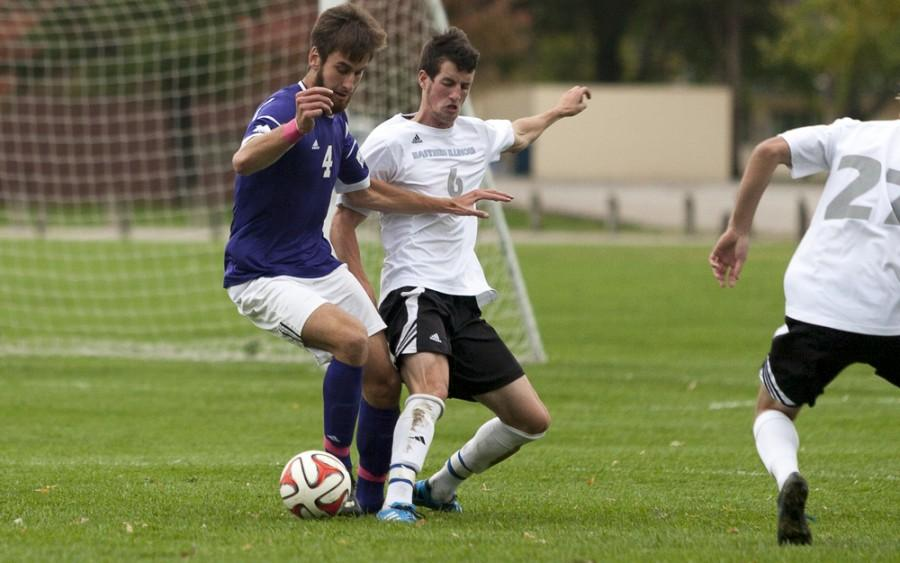 Senior Kyle Callendar fights with a Western Illinois opponent during a game on Oct. 18, 2014 at the Eastern practice field.
