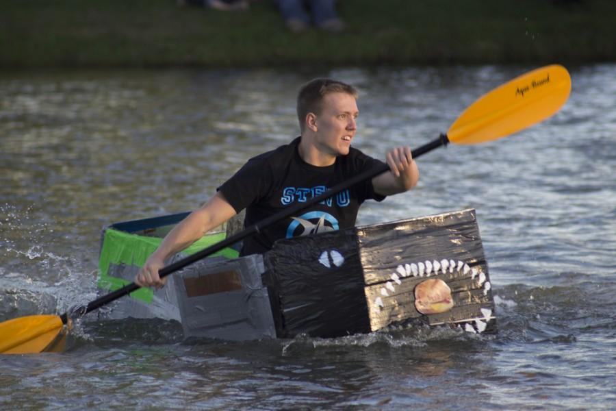 Drew King, a sophomore kinesiology and sports studies major, rows the Stevenson Hall boat to victory during the final lap of the Boat Races Thursday at Campus Pond. The races are a part of RHA's ROC Fest Week.