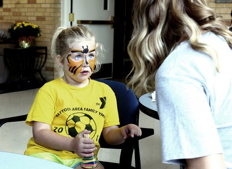 Kelsey Trigg, a Charleston resident, gets her face painted at the