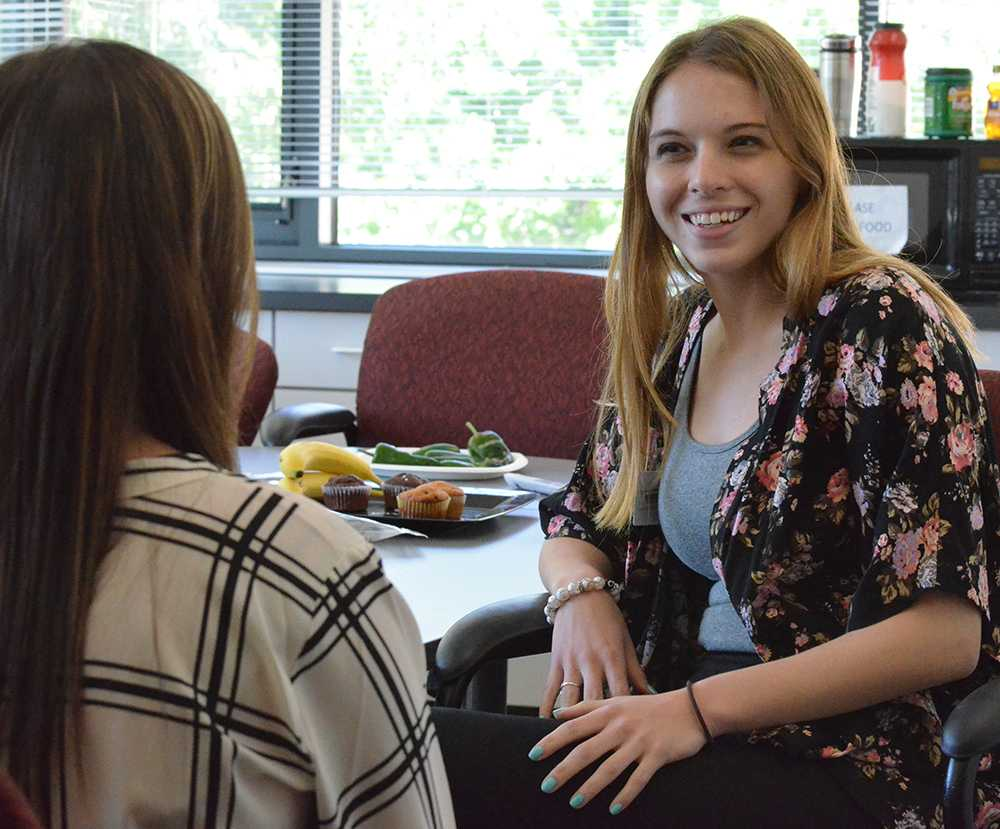 Mary Beth Xenakis, graduate assistant in the communication disorders and sciences department, and Meghan Levey, a graduate assistant  in autisim center, disscuss tacktics to help their clients on Wednesday in the Autism Center in the Human Services Building.