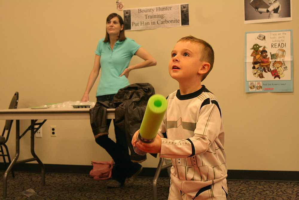 Owen Keefe, a 5-year-old Charleston resident, gets ready to hit a red balloon with his pool noodle light saber at the Star Wars Reads day event put on at the Charleston Carnegie Public Library Wednesday.