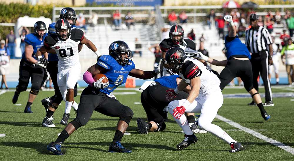 Red-shirt junior running back Devin Church blocks Southeast Missouri State's Josh Freeman on a run up the field during the Panthers' 33-28 Family Weekend win on Saturday at O'Brien Field. Church ran for 75 yards completing one touchdown during the game.