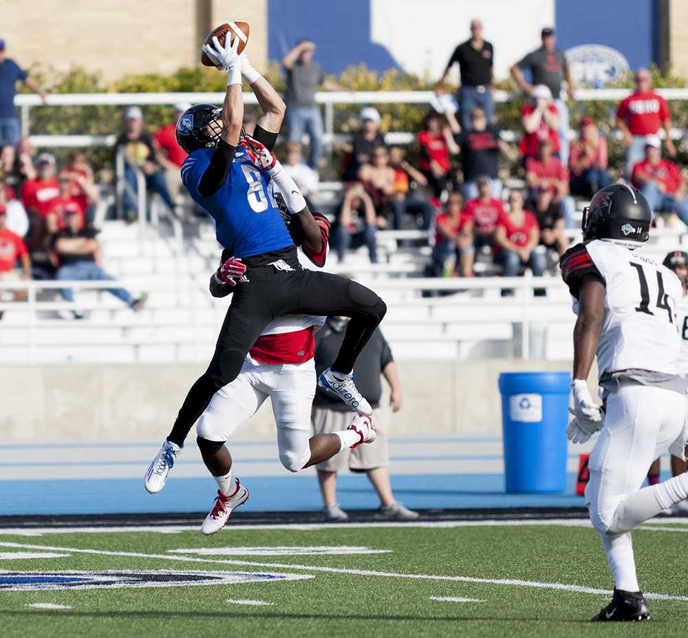Freshman wide receiver Paul Gossage makes a leap for the ball during the Panthers' 33-28 victory over Austin Peay during Family Weekend on Saturday at O'Brien Field. Gossage received 62 yards in the game.