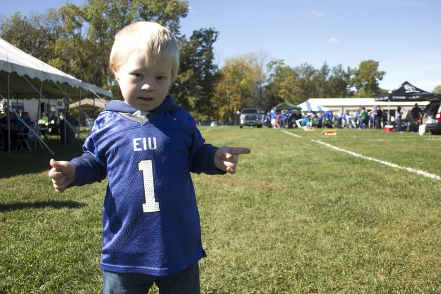 Quincy Stutzman, a five year old from Arthur, Ill., dances during tailgating  on Saturday at Lantz Arena. Stutzman was visiting his sister Ashley Stutzman for Family Weekend.