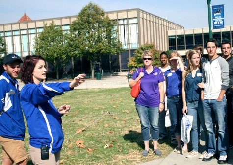 Jordan Landeck, a senior commuications major, informs a tour group of facts pertaining to the Doudna Fine Ats Center in the South Quad on Monday. She and Will Giroux (left), a sophomore health studies major, led campus tours during the open house.