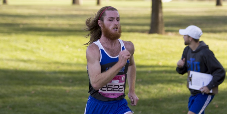 Junior Riley McInerney finshes 21st out of 250 runners during the mens 8k red race in the Bradley Pink Classic on Friday at Newman Golf Course in Peoria Ill.  McInerney finished with a time of 24:29. The men finished 6th out of 26 competing teams.