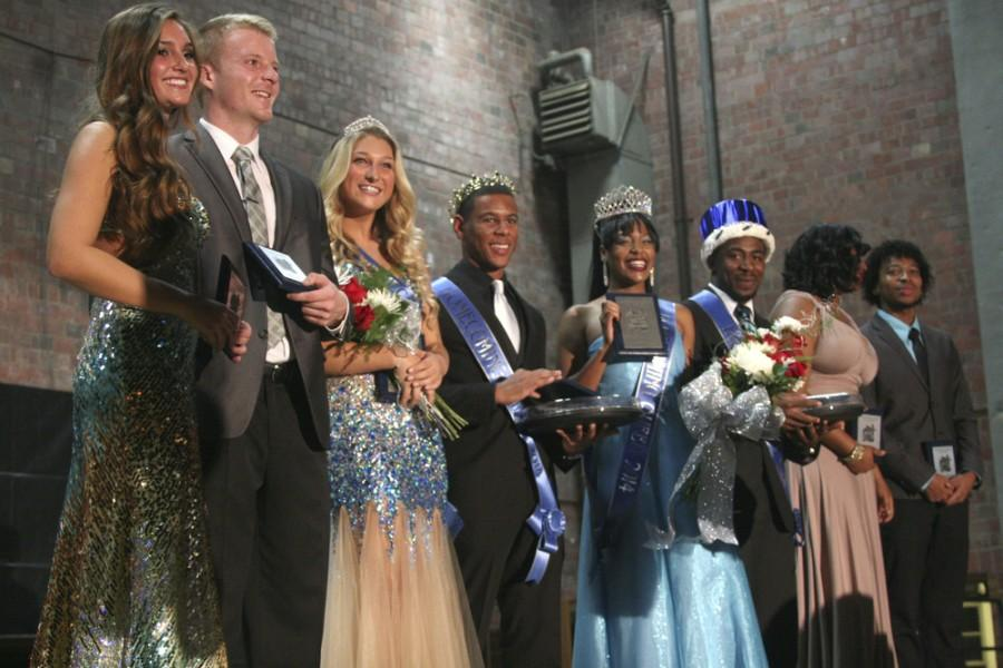 The runner up and the newly crowned homecoming court pose for photo after the Homecoming Coronation Cermony on Oct. 20, 2014 in McAfee Gymnasium. In order from left to right: Samantha DeYoung, James Smith, Catie Witt, Tylen Elliot, Alexis Lambert, Brandal Miles, Brittany Fisher and Stephen Simpson.