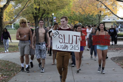 Brody Wilt, a junior sociology major, grabbed the S.L.U.T. Walk sign and led the walk around campus Tuesday.