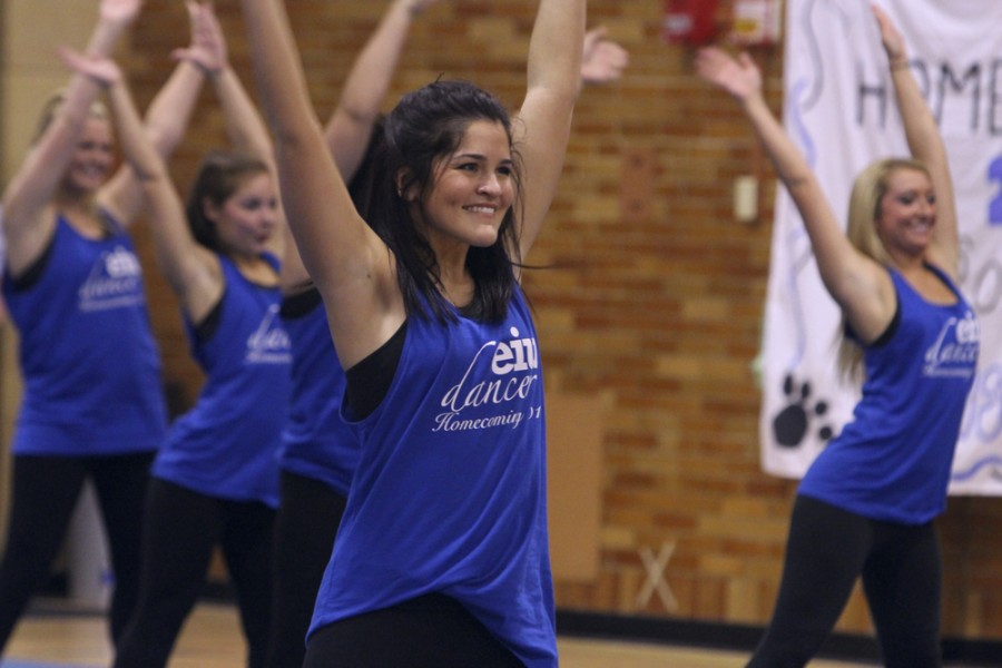 Mackenzie R. Butler, vice president and choreographer for the EIU Dancers performs with the team during the Yell Like Hell pep rally on Friday in McAfee Gym.
