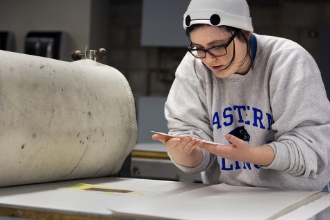 Cora Prothman, a sophomore art major, works on a intaglio print for her Printmaking I class on Thursday in the Doudna Fine Arts Center. Prothman plans on working as an animator as a career and hopes to be able to study at the California Institute of technology in the future.