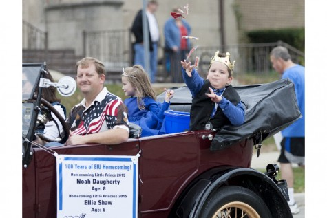 Homecoming Little Prince Noah Daugherty throws out candy during the Homecoming parade on Saturday along Sixth Street.