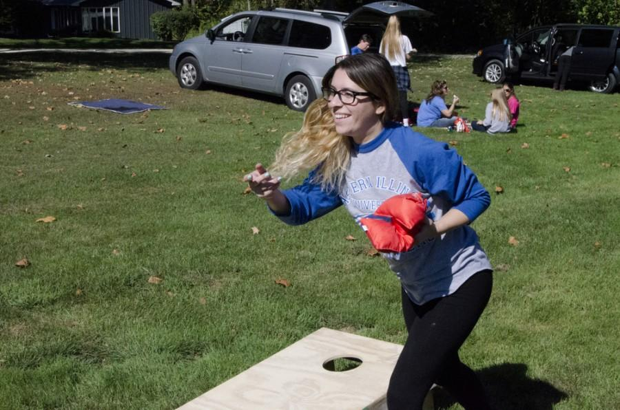 Melissa Meiselman, journior CMN: Mass Communication minor, plays bags on saturday during tailgating.