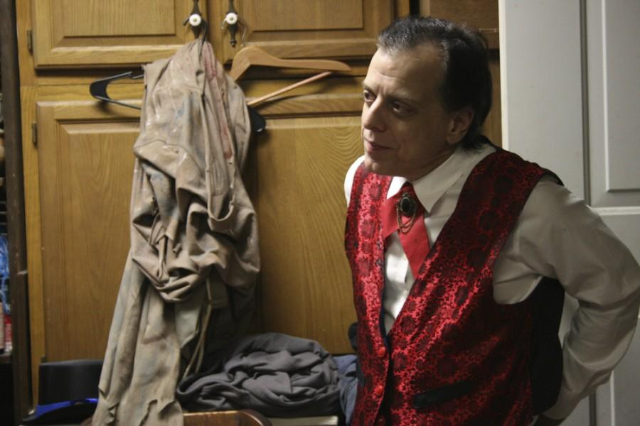 Michael Salem, the actor playing Count Dracula, gets into character in the green room.