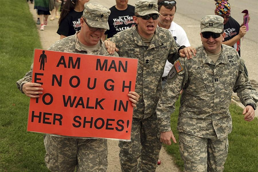Nick+Fetrell+and+Dan+Alix+hold+their+fellow+ROTC+member%2C+Craig+Sharp+as+he+struggles+to+complelte+a+mile+in+heels+during+Walk+a+Mile+in+Her+Shoes+Sunday.+ROTC+was+a+sponsor+of+the+event%2C+which+was+hosted+by+Sexual+Assault+Counseling+and+Information+Servies+%28SACIS%29+on+April+27%2C+2014.+