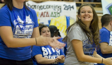 Amie Hansen, creator and president of the EIU Blue Crew, claps along with other students and staff during Yell Like Hell on Oct. 24, 2014 in the McAffee Gym.