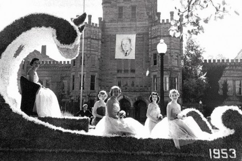 The 1953 homecoming court rides through the streets of Charleston during the Homecoming Parade.