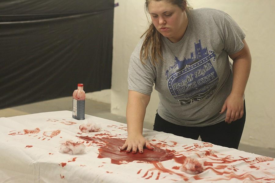 "Candice Basista, a sophomore pre-nursing major, prepares for Pemberton's ""Haunted Hospital"" on Wednesday in the basement of Pemberton Hall. Basista said this hauted house brings not just Pemberton's residents together, but the entire campus for scary fun. The haunted house is $2 for entry."