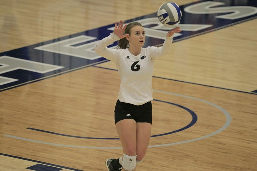 Senior libero Stephanie Wallace prepares to serve the ball against UT Martin on October 16, 2015 in Lantz Arena. The Panthers won 3-1.