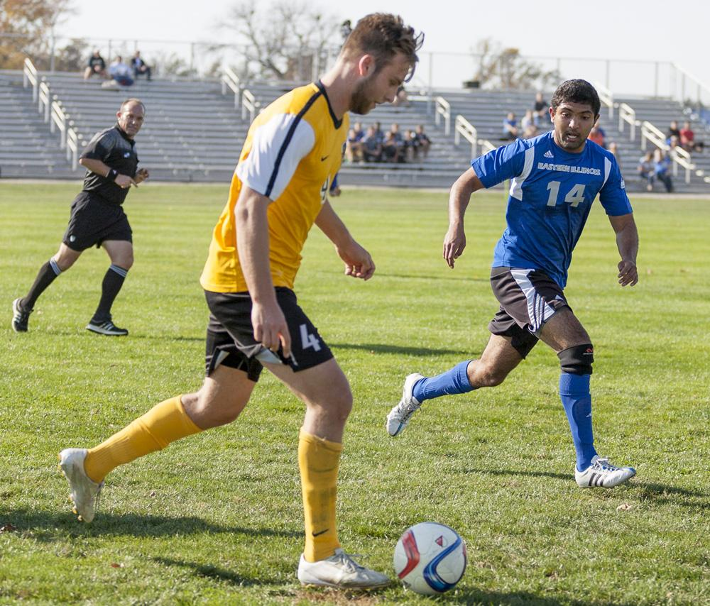 """Sophomore defender Zach Medawattage runs alongside an opponent as the Panthers fell to Northern Kentucky 2-1 on Oct. 21 at Lakeside Field. Sophomore goalkeeper Mike Novotny has said that Medawattage, """"has been a cruicial part of our defense this year and has really shined in that back line."""""""