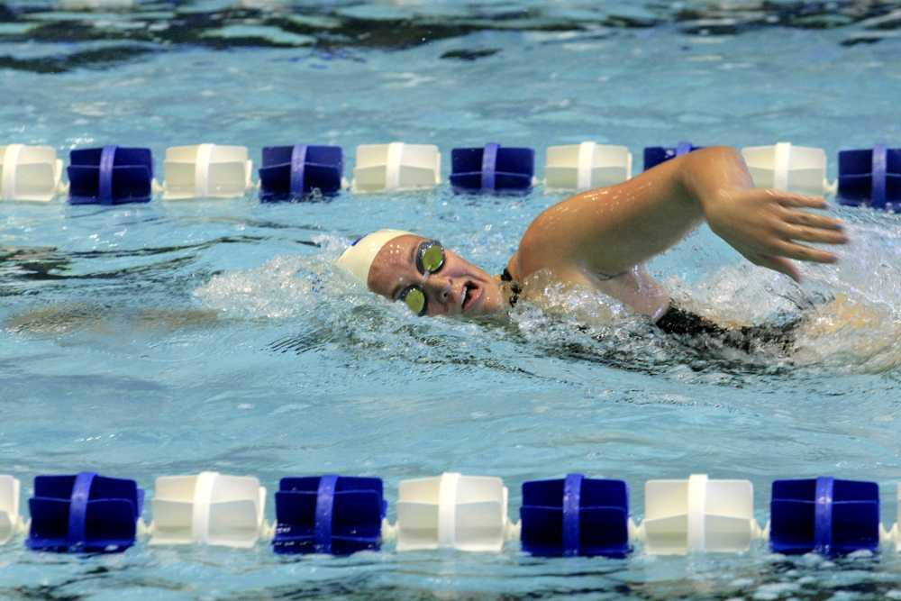 Freshman Martee Grainger swims frontstroke during the swim meet against Indiana University-Purdue University Indianapolis on Oct. 17. Grainger swam in the meet against Evansville Saturday Oct. 31 where she took 3rd place in the 200-yard freestyle event and 2nd in the 200-yard backstroke event.