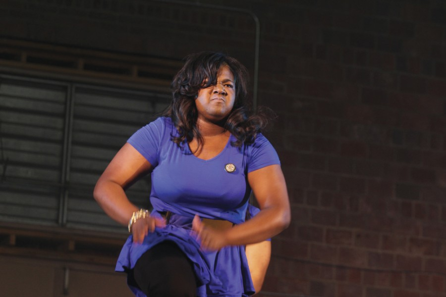 JaLisa Smith, a senior psychology major and Vice President of Sigma Gamma Rho Sorority, Inc., performs a dance during the NPHC Step Show on Nov. 8, 2014 in McAfee Gymnasium.