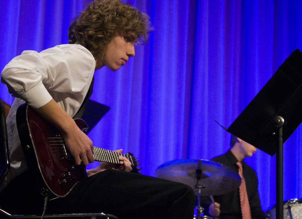 Nate Robben, a student at Belleville West High School, plays guitar at the Honor Jazz Combos event on Monday in Theatre Hall at The Doudna Fine Arts Center.