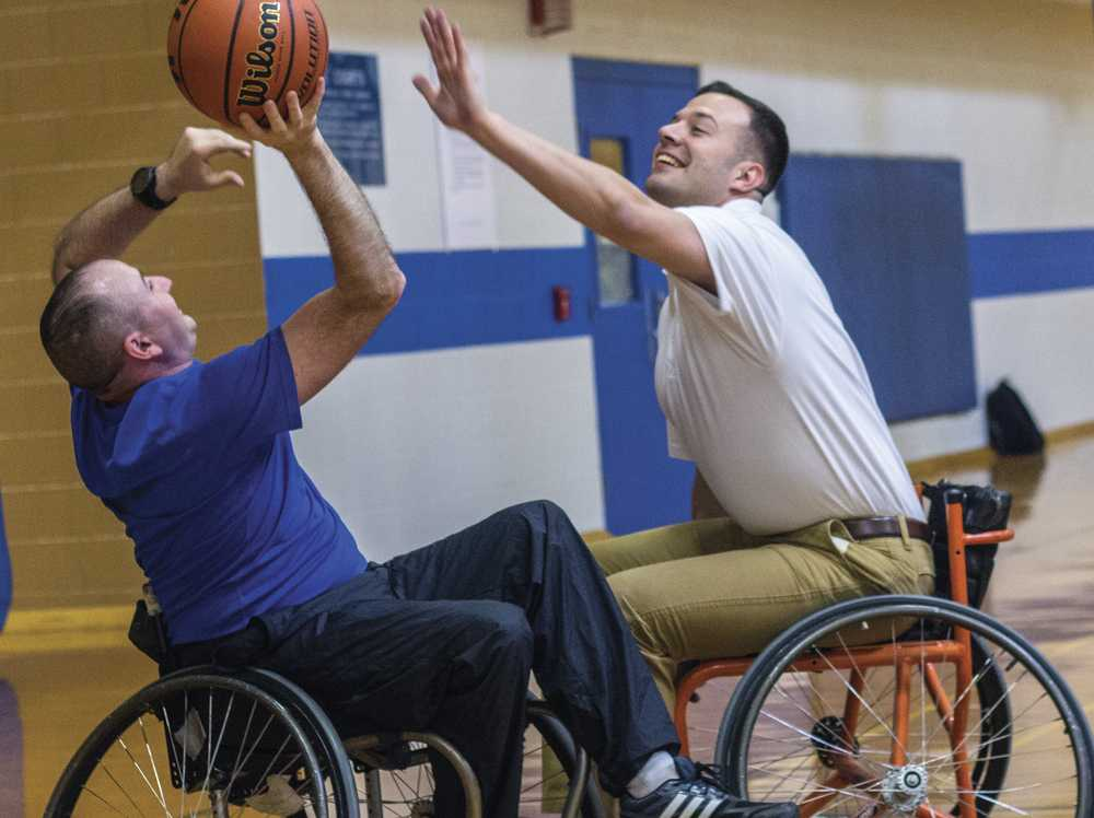 Second Lieutenant and recruiter for the ROTC Panther Battalion Cody Gallagher guards Cpt. Daniel Alix, assistant professor of millitary science, on Saturday during a game of wheelchair basketball in the Student Recreation Center. This activity was created to show students and community members the hardships faced by disabled veterans.