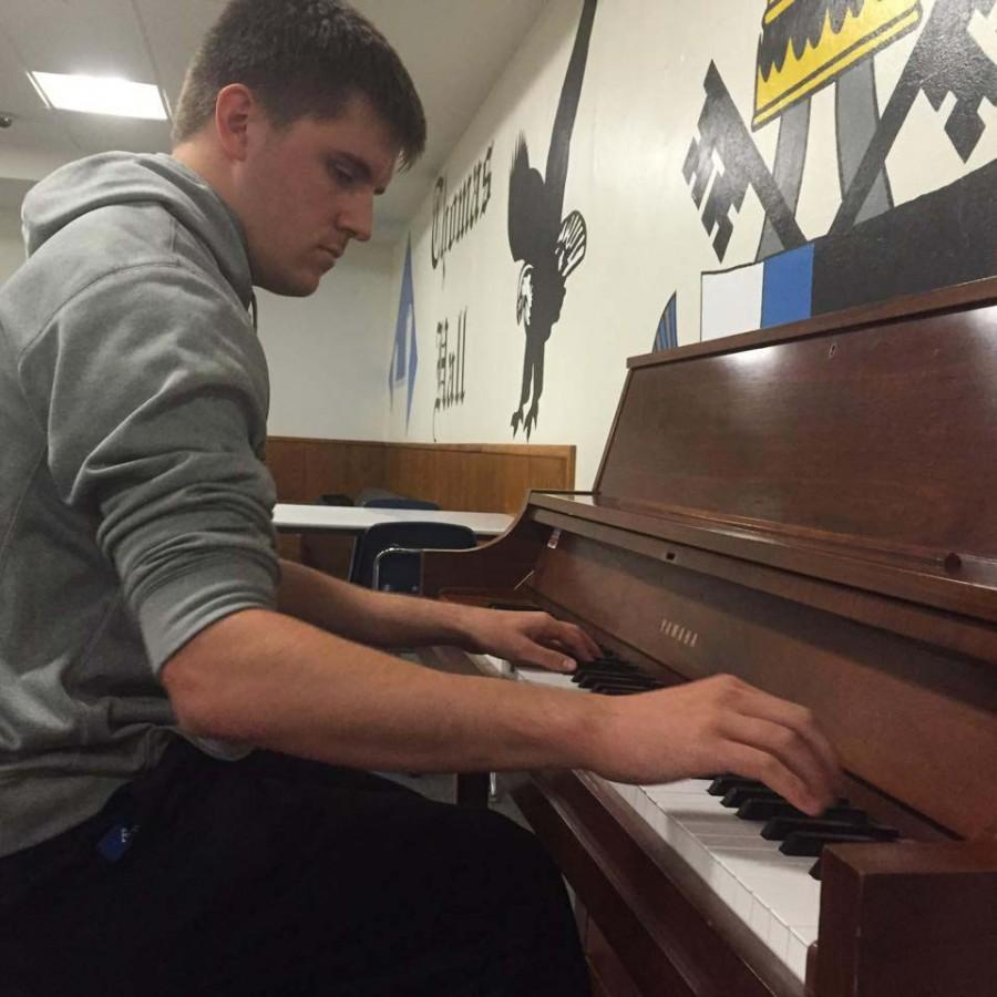 Mike Rosenbaum playing piano in Thomas Halls party room