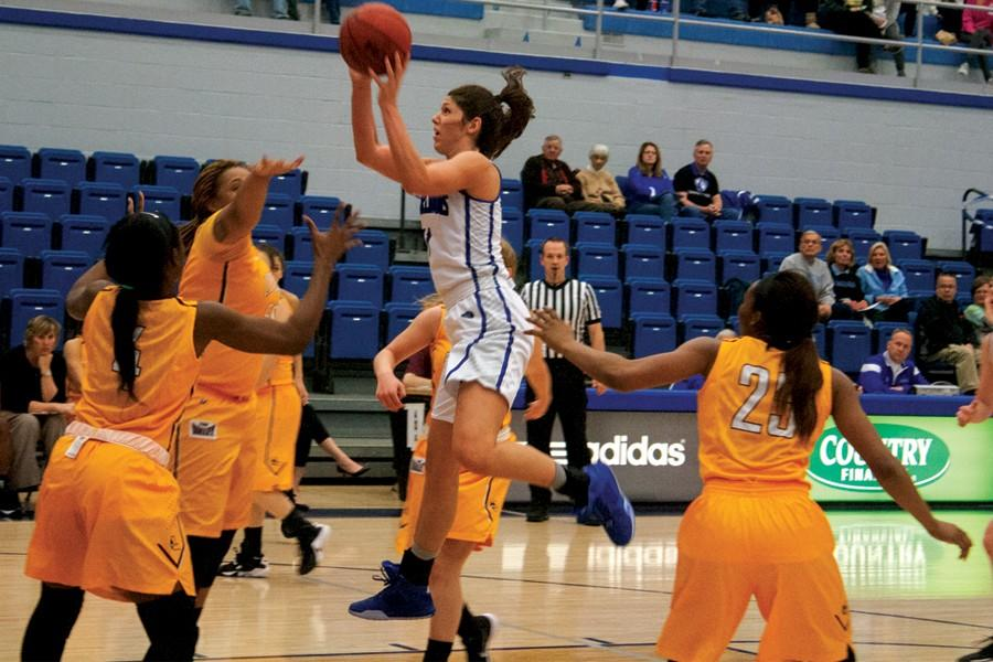Junior forward Erica Brown goes up for a layup in Tuesday's game against Loyola-Chicago in Lantz Arena. Brown contributed 15 points 2 blocks 1 assist and 1 steal.