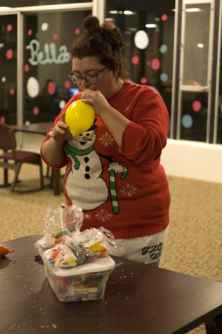 Valerie Ponce, a freshman communication studies major and recognition chair for Andrews Hall Council, makes a stress ball after the meeting in Andrews Hall Lobby Wednesday. Ponce said making the stress balls made her feel less stressed.