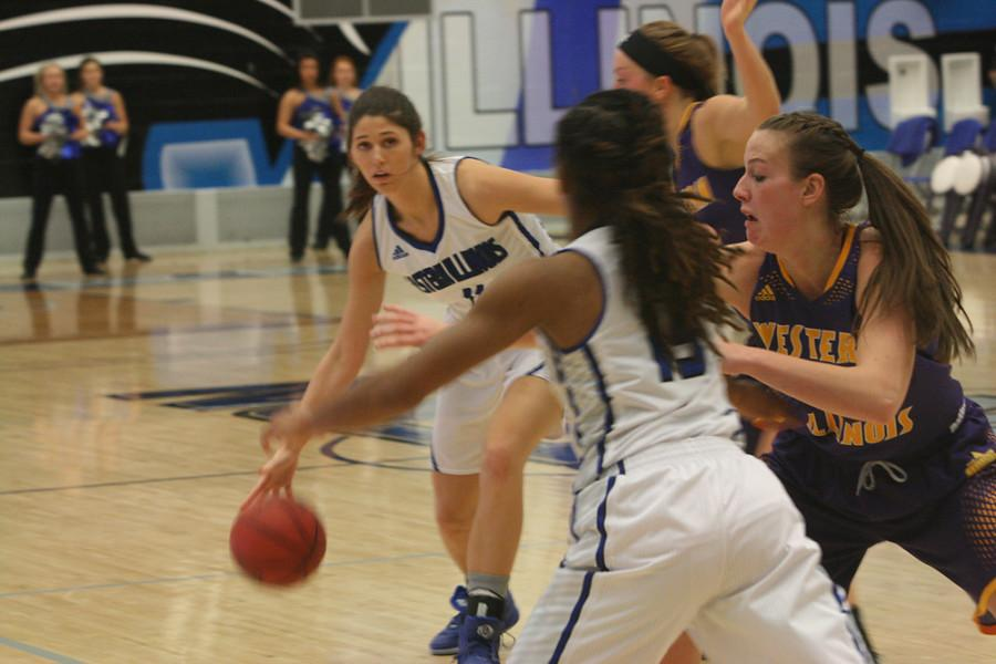 Junior forward Erica Brown prepares to pass the ball during  the Eastern Women's Basketball game against Western Illinois University on Dec. 2 in Lantz Arena.