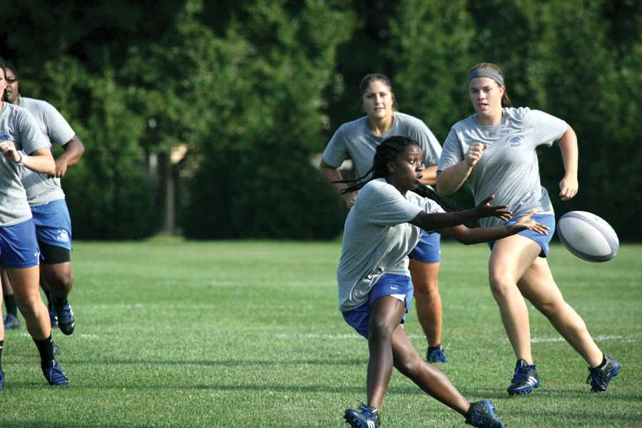 Junior wing Jasmine Gardner dives for the ball at Rugby practice September 3, 2014.