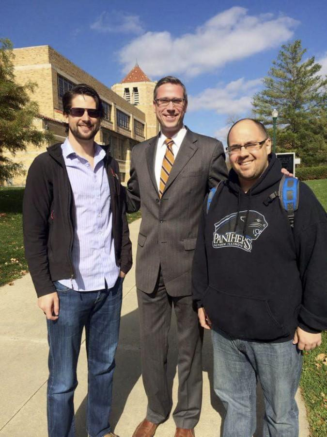 Former College Democrat members Ryan Woods and Mike Olsen stand with Illinois State Treasurer Michael Frerichs, center, outside of the Martin Luther King Jr. University Union.