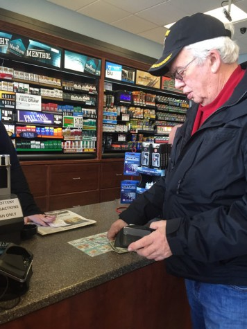 Roger Smith, a resident of Charleston purchases Powerball tickets at Mach 1 on Tuesday.