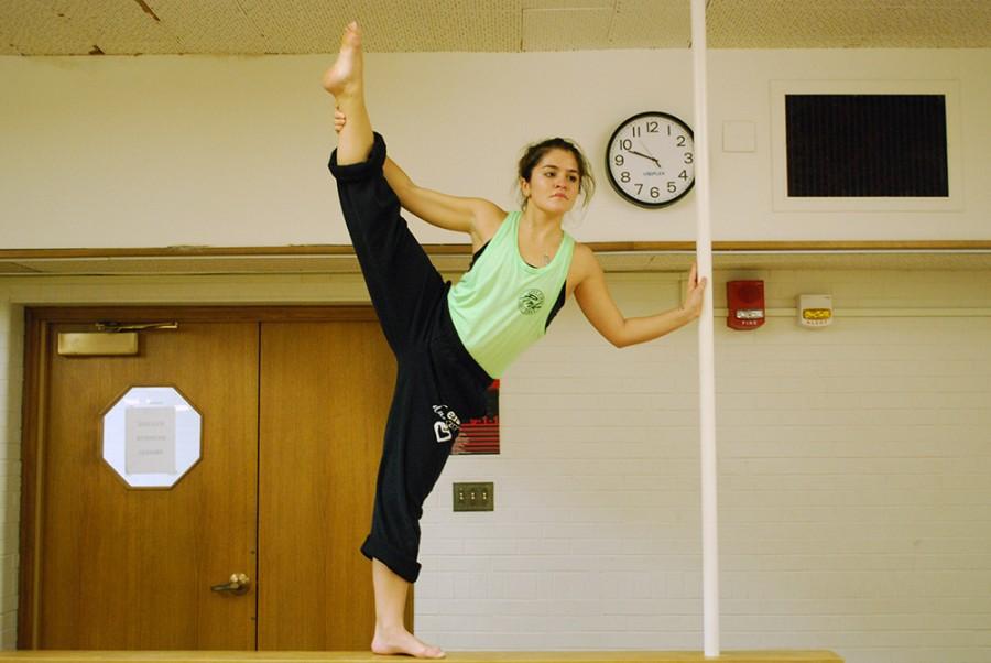 Mackenzie Butler, member of the EIU Dancers and senior art major, prepares herself in McAfee studio to dance in her last showcase before graduating in spring 2016.