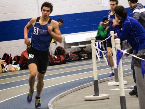 Michael Mest runs the mile at the John Craft Invitational Saturday in Lantz Field House. Mest finished with a time of 4:24.22.