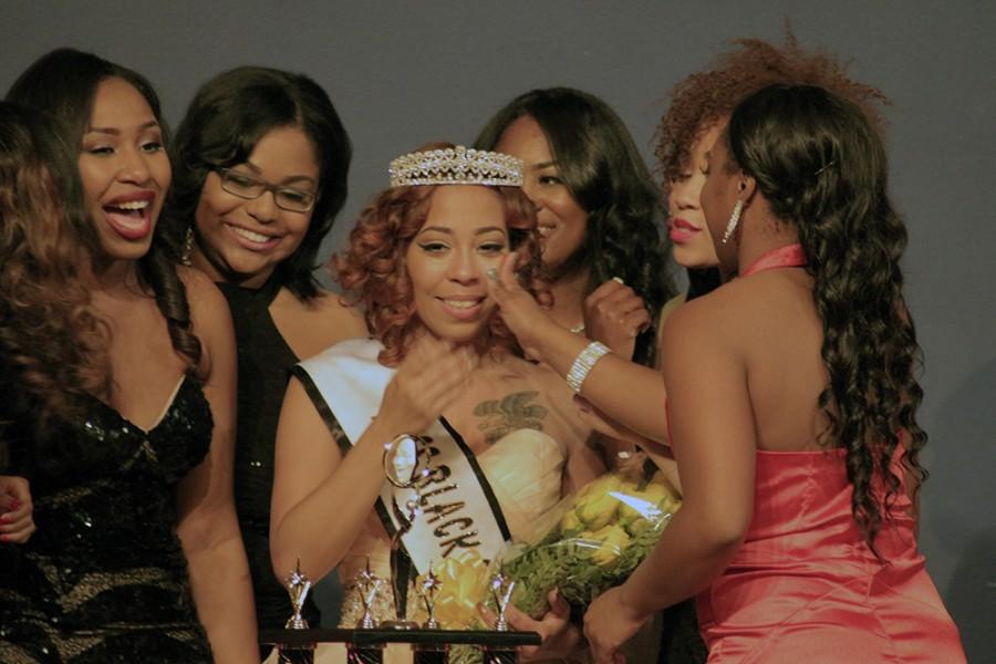 Angela Davis, a senior sociology major is congratulated by her fellow contestants after being crowned Miss Black and Gold of 2016 on Saturday in the Grand Ballroom of the Martin Luther King, Jr. University Union. Davis was victorious over nine other contestants in the pageant.