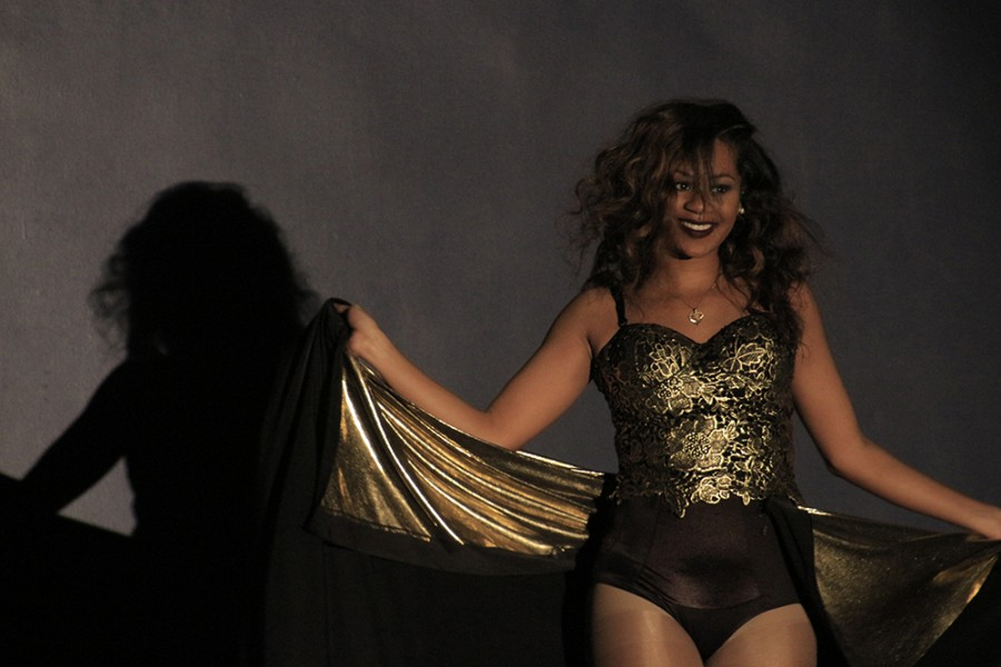 Janae Houser performs a Beyonce inspired dance routine during the talent portion of the Miss Black and Gold paganent on Saturday in the Grand Ballroom of the Martin Luther King Jr University Union.