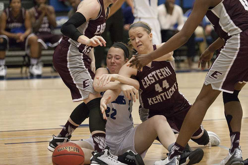 Freshman forward Brittin Boyer fights for possession of the ball during the Panthers' 75-56 loss to Eastern Kentucky on Jan. 14 in Lantz Arena. The Panthers lost to Austin Peay 80-45 on Saturday in Clarksville, Tenn.