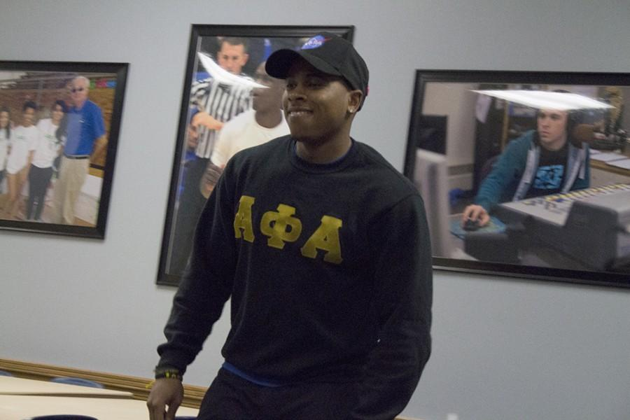 Phil Love a senior political science major auditions to model for the African Student Association's fashion show on Tuesday in the Casey Room of the Martin Luther King Jr University Union.