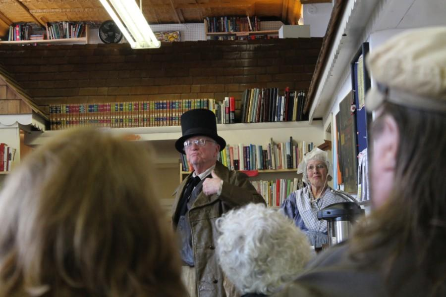 Dick Hummel, Vice President of the Five Mile House Foundation and his wife Kathy Hummel portray Nathan Ellington and Frannie Yokum Ellington in the murder reenactment at Bob's Book Store, Wednesday. Nathan Ellington died in a store where Bob's Book Store stands today.