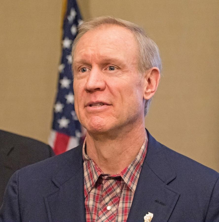 Illinois governor Bruce Rauner talks with supporters after a preview of the State of the State at the I-Hotel Ballroom on Thursday, Jan. 29, 2015.