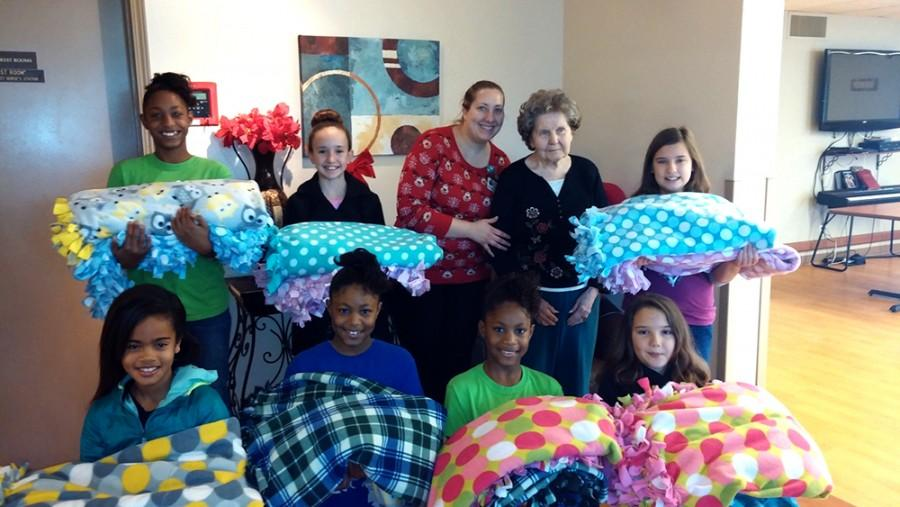 Submitted Photo | The Daily Eastern News Jefferson Elementary School Girls on the Run members deliver blankets they made to Hilltop Skilled Nursing and Rehabilitation Center.