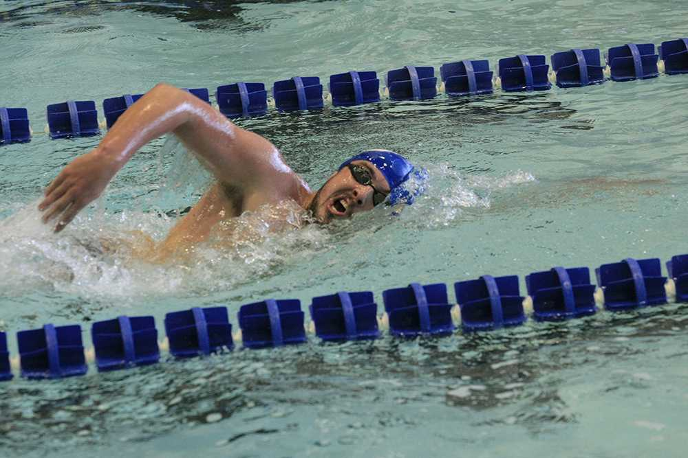 Kyle Ruckers swims the 1000 yard freestyle during the meet against Indiana University-Purdue university Indianapolis on oct. 17. Ruckert is preparing himself for the mile event at conference.