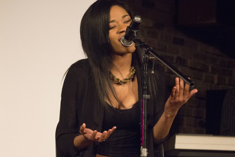 """Keyana Latimer, a sophomore sociology major sings during the """"Cycle of Love"""" piece during the Chiraq Monologues on Tuesday in 7th Street Underground."""