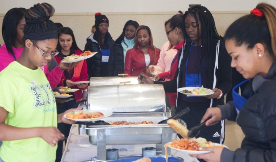 High school students grab lunch in the University Ballroom of the Martin Luther King Jr University Union during Access Granted 2016 Saturday.