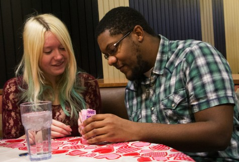 Cassidy Webb, a junior sociology major, and Jarron Gaddis, a senior computer science major, read candy hearts during their Valentine's Day date in Stevenson Dining Center. The two met at Eastern and have been dating for almost two years.