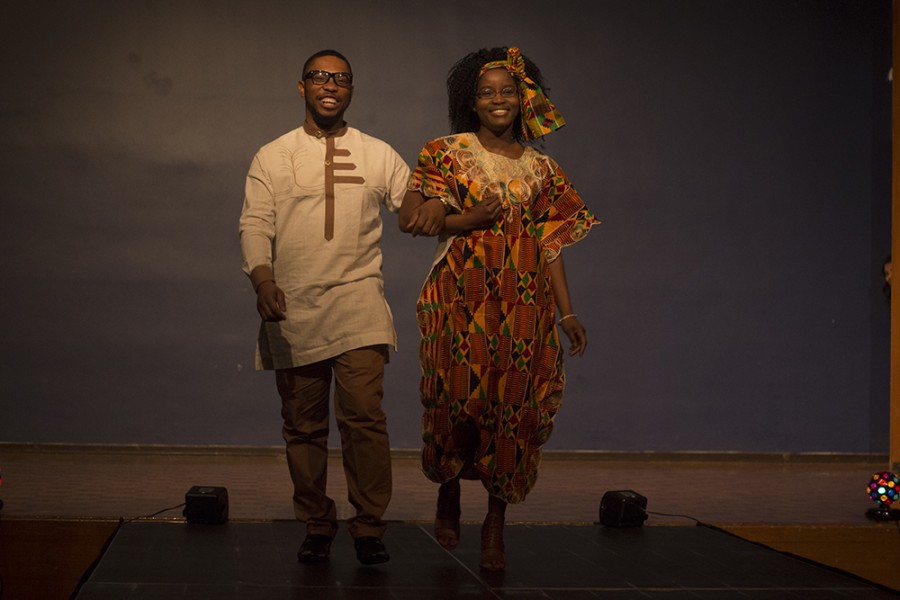 Ernest Echefu, a graduate student, and Samira Issaka, a senior chemistry major walk the stage during the Global Cultural Night fashion show in the Grand Ballroom of the Martin Luther King Jr. University Union. Issaka hails from Ghana and Echefu is from Nigeria