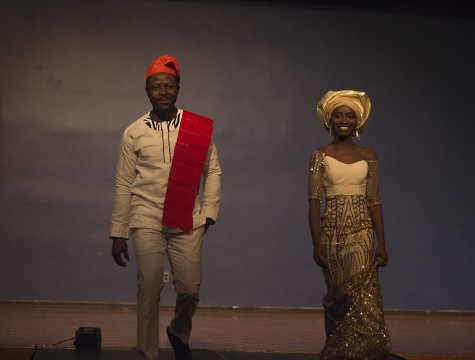 Ebede Beluchukwu, a graduate student and Tinuke Laguda, a graduate student walk the stage during Global Cultural Night fashion show on Saturday in the Grand Ballroom of the Martin Luther King Jr. University Union. The two are from Nigeria and are wearing garments from their home country.